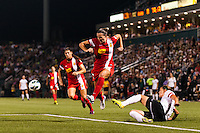 Western New York Flash defender Katherine Reynolds (16) jumps over a tackle by Portland Thorns forward Christine Sinclair (12). The Portland Thorns defeated the Western New York Flash 2-0 during the National Women's Soccer League (NWSL) finals at Sahlen's Stadium in Rochester, NY, on August 31, 2013.