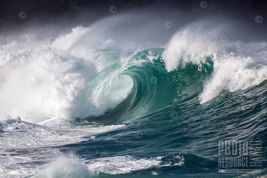 A big hollow wave breaks at Waimea Shorebreak, North Shore, O'ahu.
