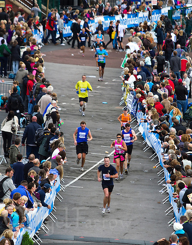 09 SEP 2011 - CHESTER, GBR - Competitors run the last few metres to the finish line of the MBNA Chester Marathon .(PHOTO (C) NIGEL FARROW)