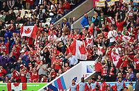 Canada supporters in the crowd celebrate a try. Rugby World Cup Pool D match between Canada and Romania on October 6, 2015 at Leicester City Stadium in Leicester, England. Photo by: Patrick Khachfe / Onside Images
