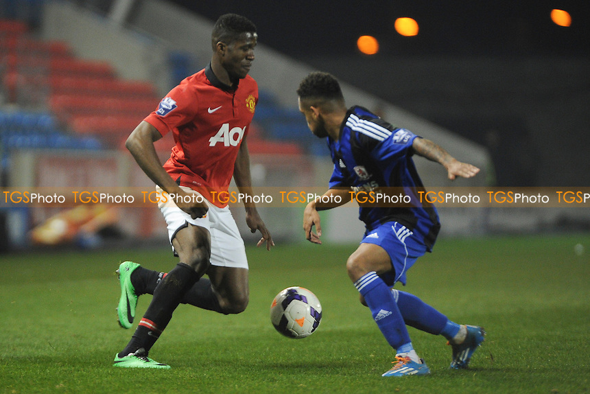 Wilfried Zaha of Manchester United tries to get past Andre Bennett of Middlesbrough - Manchester United Under-21 vs Middlesbrough Under-21 - Barclays Under-21 Premier League Football at Salford City Stadium, Manchester - 20/01/14 - MANDATORY CREDIT: Greig Bertram/TGSPHOTO - Self billing applies where appropriate - 0845 094 6026 - contact@tgsphoto.co.uk - NO UNPAID USE