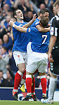 Lee Wallace and Ian Black celebrate with David Templeton as the three ex-Hearts players revel in the Rangers blue