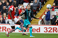 Bersant Celina of Swansea City (R) has his cross deflected by Bambo Diaby of Barnsley (L) during the Sky Bet Championship match between Barnsley and Swansea City at Oakwell Stadium, Barnsley, England, UK. Saturday 19 October 2019