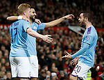 Riyad Marhez of Manchester City celebrates scoring their second goal with Kevin De Bruyne and Bernardo Silva of Manchester City during the Carabao Cup match at Old Trafford, Manchester. Picture date: 7th January 2020. Picture credit should read: Darren Staples/Sportimage