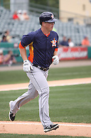 Houston Astros third baseman Matt Dominguez (30) hits a home run against the Miami Marlins during a spring training game at the Roger Dean Complex in Jupiter, Florida on March 12, 2013. Houston defeated Miami 9-4. (Stacy Jo Grant/Four Seam Images)........