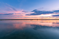 Glorious pastel coloured sunset over the flooded Tale Pan in northern Botswana