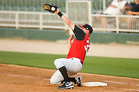 First baseman Ian Gac #33 of the Kannapolis Intimidators makes a nice catch on a bad throw against the Delmarva Shorebirds at Fieldcrest Cannon Stadium May 12, 2010, in Kannapolis, North Carolina.  Photo by Brian Westerholt / Four Seam Images
