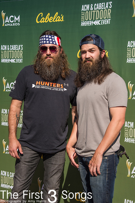 TV personalities Willie Robertson (L) and Jep Robertson attend the ACM & Cabela's Great Outdoor Archery Event during the 50th Academy Of Country Music Awards at the Texas Rangers Youth Ballpark on April 18, 2015 in Arlington, Texas.