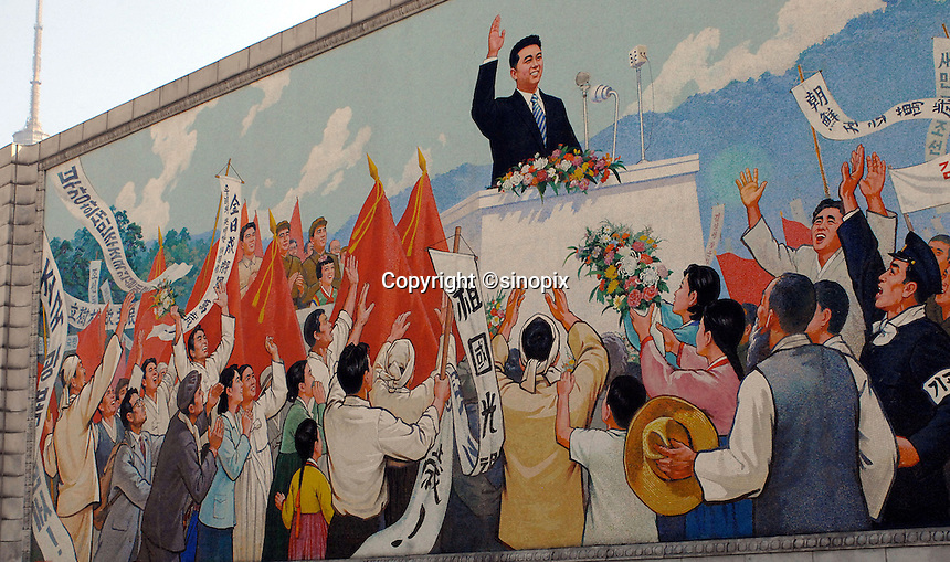 "Propaganda posters in Pyongyang, North Korea. The DPRK (Democratic People's Republic of Korea) is the last great dictatorship where the people are bombarded with images of the ""Eternal President"" Kim Il-sung who died in 1994  and his son and current leader Kim Jong-il who are worshipped like a God."
