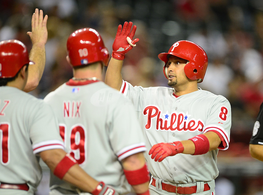 Apr. 23, 2012; Phoenix, AZ, USA; Philadelphia Phillies outfielder Shane Victorino (right) celebrates with teammates after hitting a three run home run in the ninth inning against the Arizona Diamondbacks at Chase Field. Mandatory Credit: Mark J. Rebilas-