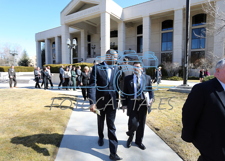Nevada Senate Democrats Aaron Ford, left, and Mark Manendo return to the Legislative Building in Carson City, Nev., on Thursday, Feb. 28, 2013, following the annual fire drill..Photo by Cathleen Allison
