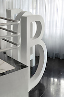 Large white sculptural letters situated by the staircase in the lobby spell out the name of the hotel