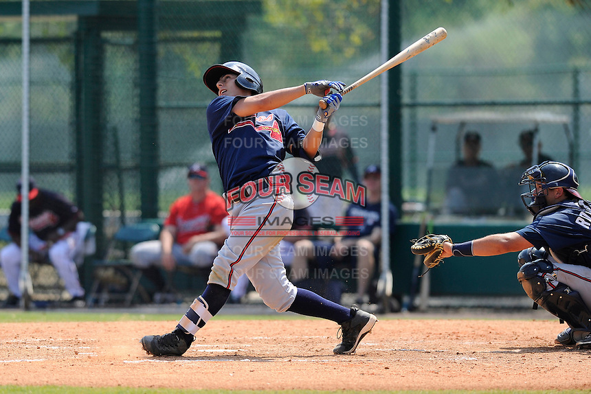 Infielder Daniel Castro (74) of the Atlanta Braves farm system in a Minor League Spring Training intrasquad game on Wednesday, March 18, 2015, at the ESPN Wide World of Sports Complex in Lake Buena Vista, Florida. The catcher is Steven Rodriguez. (Tom Priddy/Four Seam Images)