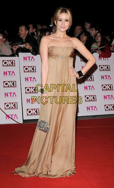 SAMMY WINWARD.The National Television Awards held at the Royal Albert Hall, London, England..October 29th, 2008.NTA red carpet arrivals full length strapless gold dress long hand on hip bag purse .CAP/CAN.©Can Nguyen/Capital Pictures.