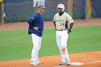 """4 March 2012:  FIU Head Coach Henry """"Turtle"""" Thomas speaks with outfielder Jabari Henry (14) as the FIU Golden Panthers defeated the Brown University Bears, 8-3, at University Park Stadium in Miami, Florida."""