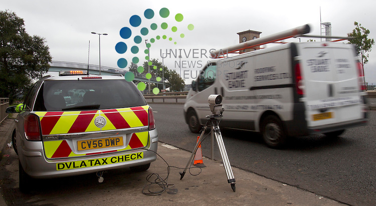 DVLA Tax checker in Glasgow - Car tax dodgers who drive vehicles they have registered as off the road could find fines popping through their letter boxes following a DVLA operation. DVLA computers know when people don't tax their vehicles and can issue fines. The agency is taking extra steps to target those who pretend their vehicles are out of use.<br /> Picture: Universal News And Sport (Scotland) 16 August 2013.