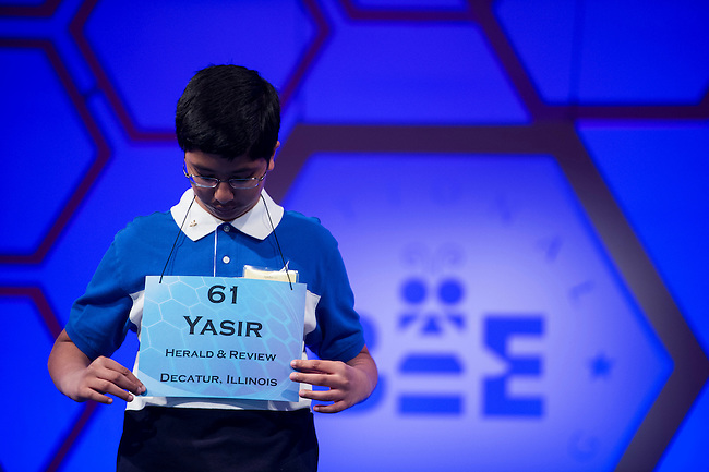 Speller No. 061, Yasir Hasnain, 12, seventh grader at Maroa Forsyth Middle School, Maroa, Illinois, competes in the preliminary rounds of the Scripps National Spelling Bee at the Gaylord National Resort and Convention Center in National Habor, Md., on Wednesday, May 29, 2013. Photo by Bill Clark