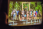 "Merrick, New York, USA. 11th June 2017.  During ""American Grit"" Season 2 premiere, (4th from right in blue swim trunks) CHRIS EDOM, 48, of Merrick, is one of 17 contestants getting ready for a lake water endurance challenge. Show was projected on large screen during Edom's backyard Viewing Party for Episode 1 of FOX network reality television series. Edom was last contestant picked for a team that episode."