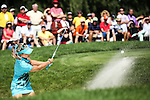 Lexi Thompson hits her ball out of the bunker and onto the 8th green at the LPGA Championship 2014 Sponsored By Wegmans at Monroe Golf Club in Pittsford, New York on August 17, 2014