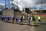 The teams walking on to the pitch before the Scottish pyramid play-off second leg between Edinburgh City (in white) and Cove Rangers at the Commonwealth Stadium at Meadowbank in Edinburgh. The match between the champions of the Lowland and Highland Leagues determined which club would play-off against East Stirlingshire for a place in the Scottish league. The second leg ended 1-1, giving Edinburgh City a 4-1 aggregate win.