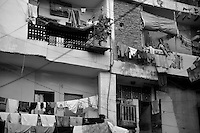 Tilak Vihar colony in New Delhi.  Tilak Vihar in New Delhi is called the widow colony. Widows and children of Sikh who were killed in 1984 Sikh Genocide live here.  4000 Sikhs were killed in 72 hours alone in Delhi but no body till date got punished for such a human crime. Illiteracy, Drug addiction, child labour and immense poverty characterize the area. 25 years ago all the male family members above the age of  15 were killed and burnt living their uneducated widows and children to suffer even after 25 years. The present generation is jobless, alcoholic and lost their directions in life. November 2009. New Delhi, India, Arindam Mukherjee