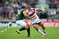 Male Sa'u of Japan in possession. Rugby World Cup Pool B match between South Africa and Japan on September 19, 2015 at the Brighton Community Stadium in Brighton, England. Photo by: Patrick Khachfe / Onside Images