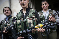 "Kurdish female fighters, members of the ""Popular Protection Units"" (YPG), are seen in the majority-Kurdish Sheikh Maksoud district of the northern Syrian city of Aleppo. The YPG stands in the neighborhood as clashes sparked out after Syrian opposition fighters entered into the Kurdish area forcing thousands of civilians to flee into safe areas outside of Aleppo City. Since then, the neighborhood is being bombed and shelled by Syrian forces in its attempt to sweep out the opposition fighters from the area."