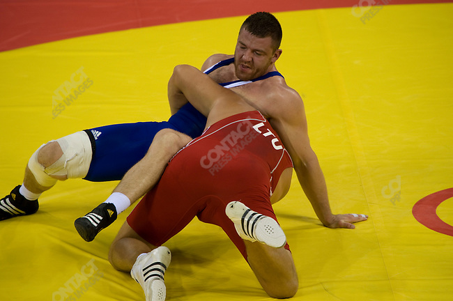Mindaugas Mizgaitis in red (Lithuania) - bronze  vs Yannick Szczepaniak (France) 120kg Grecco-Roman Wrestling, CAU Gymnasium, Summer Olympics, Beijing, China, August 14, 2008