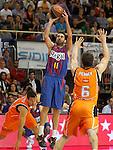 Baloncesto Fuelabrada's Sergio Sanchez (l) and Kirk Penney (r) and FC Barcelona Regal's Juan Carlos Navarro during Liga Endesa ACB match.October 30,2011. (ALTERPHOTOS/Acero)