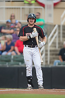 Mason Robbins (10) of the Kannapolis Intimidators looks to the third base coach for a sign during the game against the West Virginia Power at Intimidators Stadium on July 3, 2015 in Kannapolis, North Carolina.  The Intimidators defeated the Power 3-0 in a game called in the bottom of the 7th inning due to rain.  (Brian Westerholt/Four Seam Images)