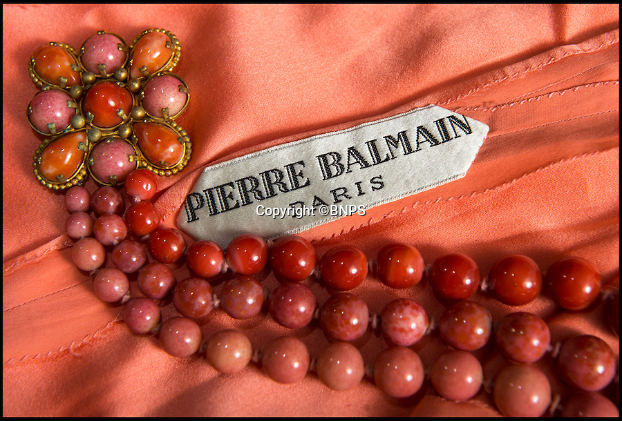 BNPS.co.uk (01202 558833)<br /> Pic: PhilYeomans/BNPS<br /> <br /> Pierre Balmain was one of the most famous names in high fashion in the 1960's. The necklace was also worn by Loren in the film.<br /> <br /> Dressed to thrill - the stunning dress that led to Peter Sellers infatuation with screen goddess Sophia Loren is coming up for auction - but you may have to actually be a Miliionairess to afford it.<br /> <br /> Sophia Loren stripped off the salmon pink Balmain gown in a racy scene from the 1960 blockbuster 'The Millionairess' and unlikely leading man Peter Sellers was so entranced by the beautiful young italian star that he offered to leave his new wife for her.<br /> <br /> Dukes auctioneers in Dorchester are now selling the dress along with two others from the film and haute couture expert Antoinette Rogers says it could go for up to £10,000 thanks to its unique and glamorous provenance.