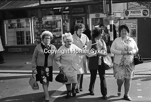 Senior  Hen Do, mature women having a party Girls day out, Grannies. Blackpool the Golden Mile. Lancashire England. 1974.<br />