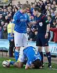 Dundee United v St Johnstone.....21.02.15<br /> Brian Easton has words with Willie Collum after Simon Lappoin was taken out by Ryan McGowan<br /> Picture by Graeme Hart.<br /> Copyright Perthshire Picture Agency<br /> Tel: 01738 623350  Mobile: 07990 594431