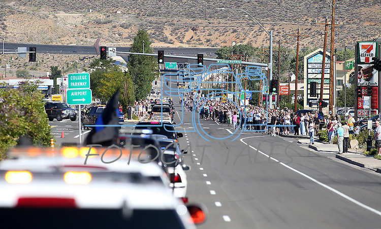 Thousands of mourners lined the route through North Carson City as a procession travels to a memorial service for Carson City Sheriff's Deputy Carl Howell in Reno, Nev., on Thursday, Aug. 20, 2015. Howell was shot and killed early Saturday morning after responding to a domestic violence call. (Cathleen Allison/Las Vegas Review-Journal)