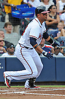 Atlanta Braves second baseman Martin Prado #14 swings at a pitch during a game against the Colorado Rockies at Turner Field on September 3, 2012 in Atlanta, Georgia. The Braves  defeated the Rockies 6-1. (Tony Farlow/Four Seam Images).