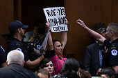 A demonstrator shouts as Judge Brett Kavanaugh arrives prior to a hearing before the United States Senate Judiciary Committee on his nomination as Associate Justice of the US Supreme Court to replace the retiring Justice Anthony Kennedy on Capitol Hill in Washington, DC on Tuesday, September 4, 2018.Credit: Alex Edelman / CNP