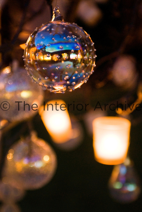 The lights of the inner courtyard are reflected in this glass bauble
