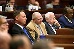 From left, Nevada lawmakers Mike Sprinkle, Joe Hardy, Lynn Stewart and Harvey Munford  listen as Republican Rep. Joe Heck speaks to a joint session at the Legislative Building in Carson City, Nev., on Monday, March 30, 2015. <br /> Photo by Cathleen Allison
