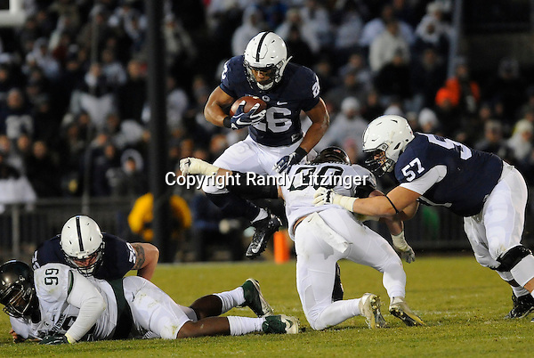 STATE COLLEGE, PA - NOVEMBER 26:  Penn State RB Saquon Barkley (26) hurdles jumps over Michigan State LB Riley Bullough (30) as he tries to tackle him. The Penn State Nittany Lions defeated the Michigan State Spartans 45-12 to win the Big Ten East Division on November 26, 2016 at Beaver Stadium in State College, PA. (Photo by Randy Litzinger/Icon Sportswire)