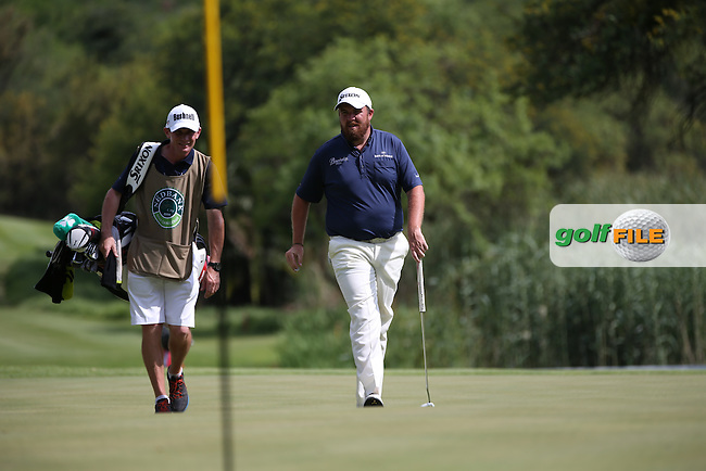 Shane Lowry (IRL) and caddie Dermot step onto the 16th green for a birdie chance during the Final Round of the 2014 Nedbank Golf Challenge at the Gary Player Country Club, Sun City Resort, South Africa. Picture:  David Lloyd / www.golffile.ie