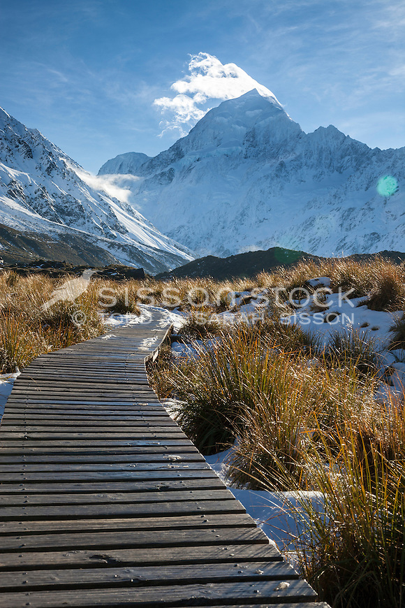 Aoraki Mt Cook towers above the boardwalk on the Hooker Valley track. South Island New Zealand