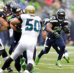 Seattle Seahawks running back Marshawn Lynch runs against Jacksonville Jaguars at CenturyLink Field in Seattle, Washington on September 22, 2013. The Seahawks beat the Jaguars 45-17. ©2013. Jim Bryant Photo. ALL RIGHTS RESERVED.
