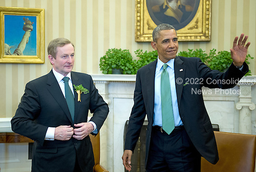 United States President Barack Obama, right, waves to the press pool as he completes his meeting Prime Minister Enda Kenny of Ireland in the Oval Office of the White House in Washington, D.C. on Friday, March 14, 2014.<br /> Credit: Ron Sachs / Pool via CNP