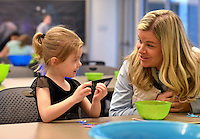 STAFF PHOTO BEN GOFF  @NWABenGoff -- 12/27/14 Allison Rupp helps her daughter Tatum Rupp, 3, of Bentonville decorate her animal cutout during the Winter Break Wonders: Winter Animals free drop-in program at Crystal Bridges Museum of American Art in Bentonville on Saturday Dec. 27, 2014.