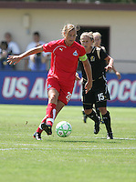 Abby Wambach (20) dribbles the ball ahead of Tiffeny Milbrett (15). FC Gold Pride defeated Washington Freedom 3-2 at Buck Shaw Stadium in Santa Clara, California on August 1, 2009.