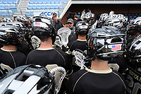 CHAPEL HILL, NC - MARCH 10: Head coach Mike Pressler of Bryant University talks to his team during a game between Bryant and North Carolina at Dorrance Field on March 10, 2020 in Chapel Hill, North Carolina.