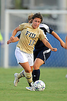 27 August 2011:  FIU's Kelly Ann Hutchinson (12) gets past Akron's Ashley Hughes (7) in the first half as the FIU Golden Panthers defeated the University of Arkon Zips, 1-0, at University Park Stadium in Miami, Florida.