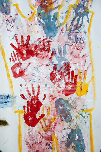 Hand prints on a poster; protest  against the building of dams in the Amazon.