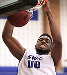 Southwestern Illinois College hosted the Jefferson Community and Technical College in an afternoon game on Saturday at the home of the Blue Storm. SWIC's Ekene Anachebe (00) dunks the ball late in the first half.