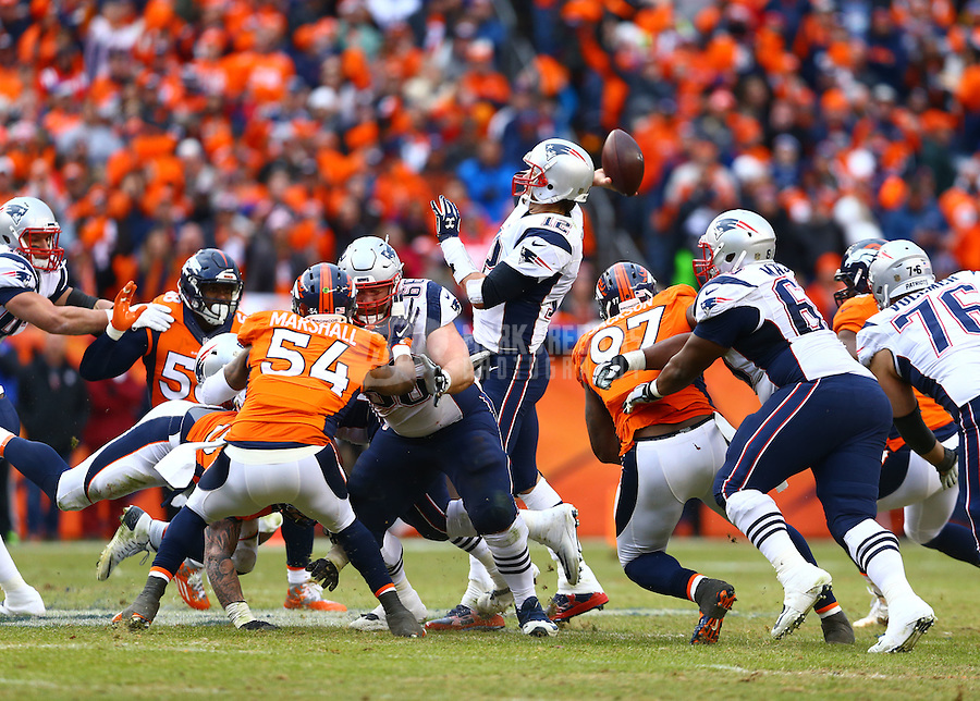 Jan 24, 2016; Denver, CO, USA; New England Patriots quarterback Tom Brady (12) throws a pass against the Denver Broncos in the AFC Championship football game at Sports Authority Field at Mile High. Mandatory Credit: Mark J. Rebilas-USA TODAY Sports